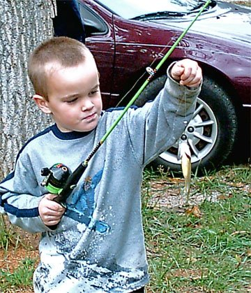Jacob's first time ever catching a fish!!! W